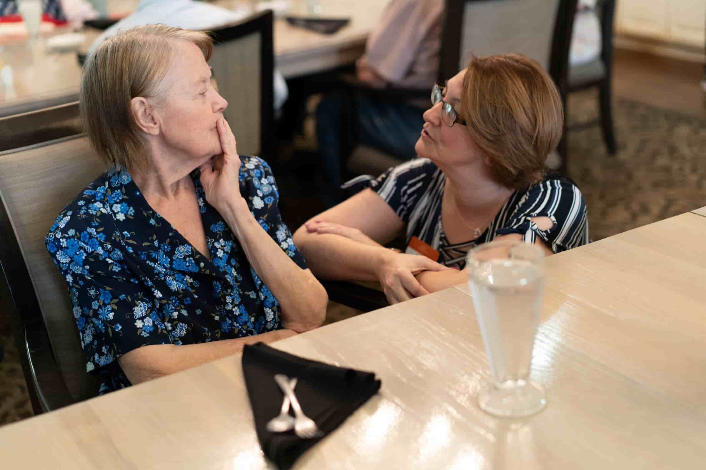staff talking with senior living resident