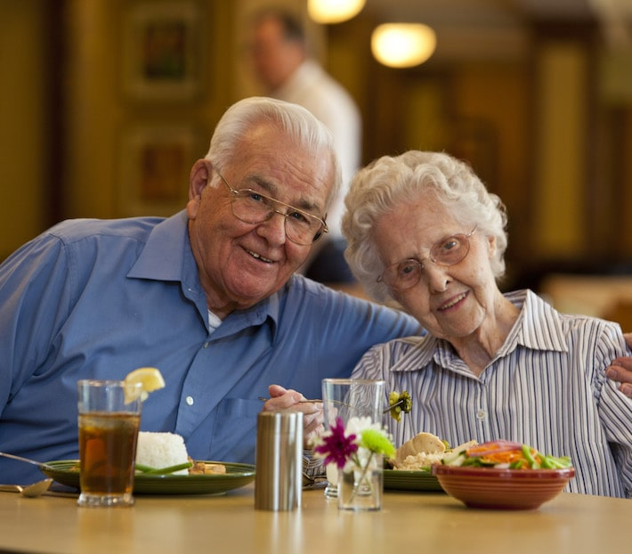 Elderly couple enjoying dinner at Villagio Senior Living