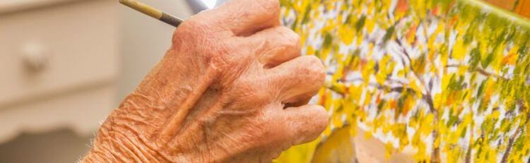seniors hand and canvas
