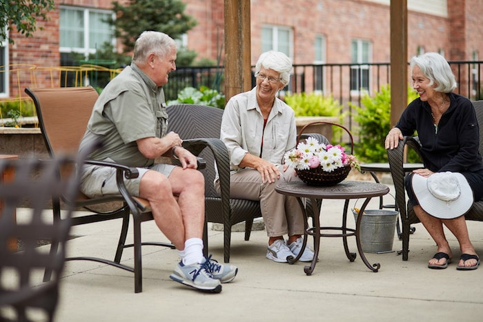 senior living residents sitting outside