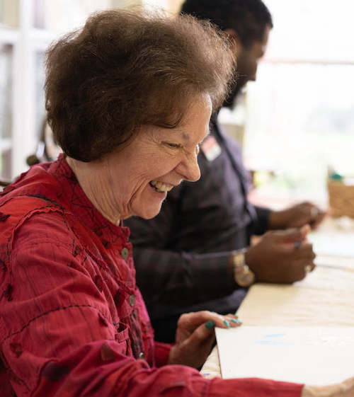 senior woman in drawing class